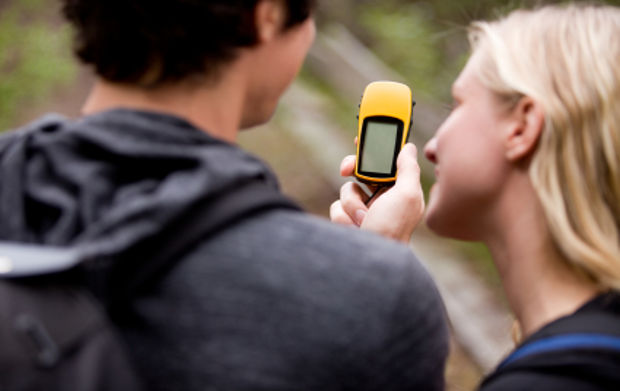 Couple looking at Geocaching GPS